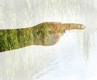Vrouwelijke hand Dubbele blootstelling Stock Foto