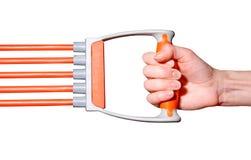 Vrouwelijke hand met de expander stock afbeelding