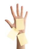 Vrouwelijke hand met lege nota's Stock Foto's