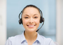 Vrouwelijke helpline exploitant met hoofdtelefoons Stock Foto