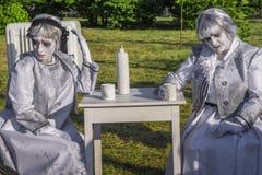 Vrouwelijke het leven standbeelden stock afbeeldingen
