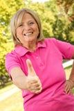 Vrouwelijke hogere duim Stock Foto