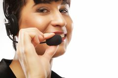 Vrouwelijke klantenondersteuningsexploitant met hoofdtelefoon en het glimlachen Stock Afbeelding
