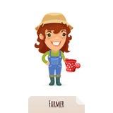 Vrouwelijke Landbouwer With een Gieter Stock Foto's