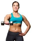 Vrouwelijke oefeningen met vrije gewichten Royalty-vrije Stock Afbeeldingen