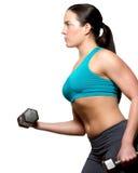 Vrouwelijke oefeningen met vrije gewichten Royalty-vrije Stock Afbeelding