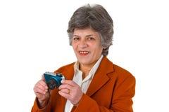 Vrouwelijke oudste met camera royalty-vrije stock foto