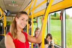 Vrouwelijke passagier in een bus stock foto's