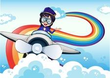 Vrouwelijke proef drijvend het vliegtuig en een regenboog in de hemel stock illustratie