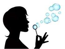 Vrouwelijke silhouet en zeepbels Royalty-vrije Stock Afbeeldingen