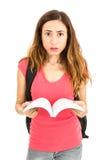Vrouwelijke student die verward kijken Stock Afbeeldingen