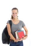 Vrouwelijke student met bos van boeken Royalty-vrije Stock Fotografie