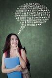 Vrouwelijke student met Webpictogrammen Stock Foto