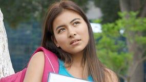Vrouwelijke Student Thinking Or Confused stock foto's