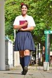 Vrouwelijke Student Walking To School royalty-vrije stock fotografie