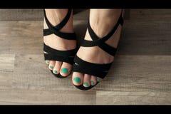 Vrouwelijke voet met pedicure Stock Foto's