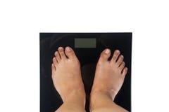 Vrouwelijke voet op gewichtsschaal Royalty-vrije Stock Foto