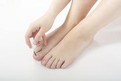 Vrouwelijke voeten pedicure stock afbeelding