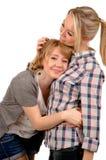 Vrouwelijke vrienden die comfort nemen van Stock Fotografie