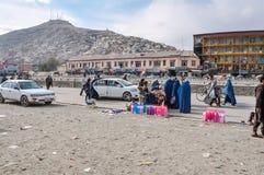 Vrouwen in blauwe burqas in Afghanistan royalty-vrije stock foto's