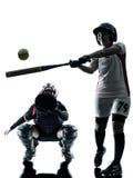 Vrouwen die geïsoleerde het silhouet spelen van softballspelers royalty-vrije stock fotografie