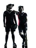 Vrouwen die geïsoleerde het silhouet spelen van softballspelers Royalty-vrije Stock Foto