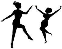 Vrouwen die in silhouet dansen Stock Fotografie