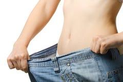 Vrouwen en jeans van de grotere grootte stock afbeeldingen