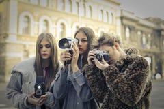 Vrouwen het filmen Stock Foto's