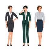 Vrouwen in kostuums voor bureau Stock Foto's