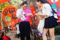 Vrouwen met babys Stock Foto's