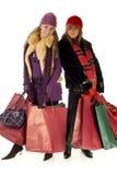 Vrouwen met het winkelen zakken Stock Foto's