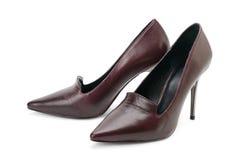 Vrouwen` s high-heeled schoenen die op wit worden geïsoleerd stock foto's