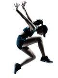 Vrouwenagent jogger het springen silhouet stock foto