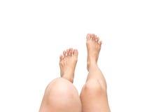 Vrouwenbenen die 1 hangen Stock Afbeelding