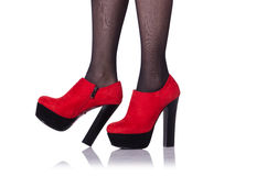 Vrouwenbenen met rode schoenen Stock Fotografie