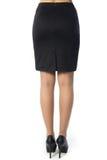 Vrouwenbenen met zwarte schoenen op witte achtergrond Royalty-vrije Stock Fotografie