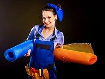 Vrouwenbouwer met bouwhulpmiddelen. Stock Foto's