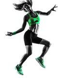Vrouwengeschiktheid het springen oefeningensilhouet Royalty-vrije Stock Foto