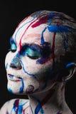 Vrouwengezicht met verf royalty-vrije stock foto's
