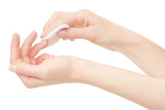 Vrouwenhand en het vlekkenmiddel van de spijkervernis, aceton stock afbeeldingen