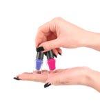 Vrouwenhanden met nagellakken royalty-vrije stock afbeeldingen