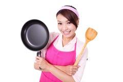 Vrouwenhuisvrouw het koken Stock Foto