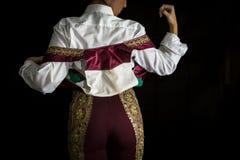 Vrouwenstierenvechter door zich met vest op uw rug te kleden royalty-vrije stock afbeeldingen