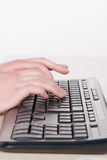 Vrouwentypes op het toetsenbord Stock Afbeeldingen