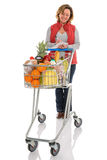 Vrouwenvoedsel die met geïsoleerd karretje winkelen Royalty-vrije Stock Fotografie