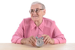 Vrouwenzitting met klok Royalty-vrije Stock Afbeeldingen