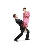 Vrouwenzitting op de handen haar echtgenoot Stock Foto