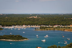 Vrsar harbor. View on harbor, camping, Funtana village, island and luxury yachts from Vrsar city bell tower Royalty Free Stock Photography