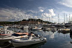 Vrsar seaport. Little boats on harbor and view to Pineta hotel in seaside resort Vrsar, Istria, Croatia Stock Photo
